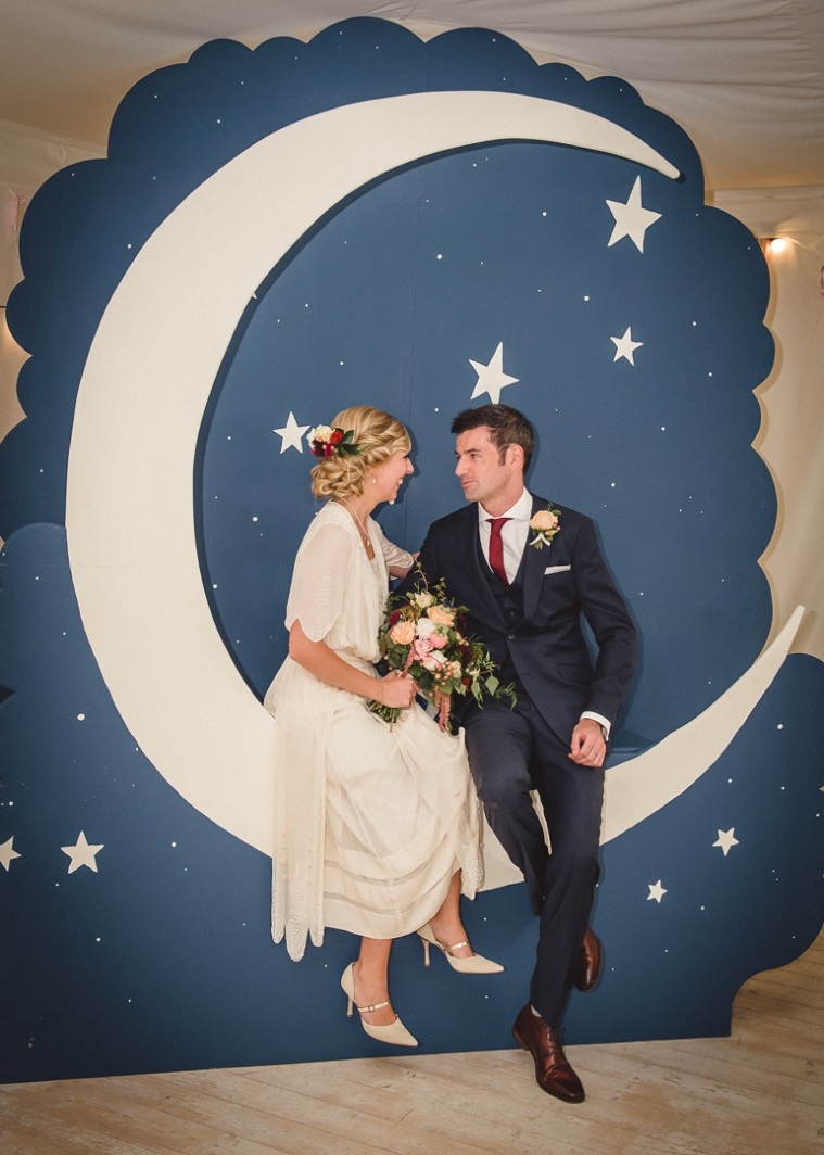 Stunning moon photo booth for wedding. Edwardian paper moon theme event, featuring original backdrop. Southeast Ireland Hire. Classy and elegant wedding decor. www.janehayescreative.com